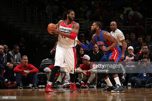 Nene Hilario of the Washington Wizards handles the ball against the Detroit Pistons on November 12 2014 at the Verizon Center in Washington DC NOTE...