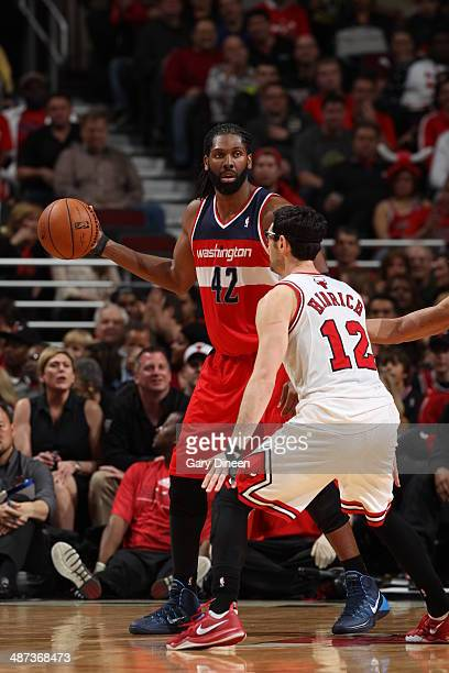 Nene Hilario of the Washington Wizards handles the ball against the Washington Wizards in Game 5 of the Eastern Conference Quarterfinals in the 2014...