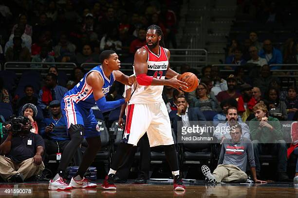 Nene Hilario of the Washington Wizards handles the ball against the Philadelphia 76ers during a preseason game on October 6 2015 at Verizon Center in...