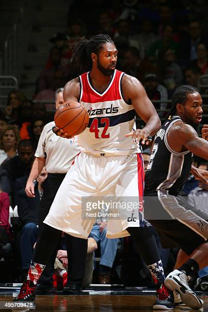 Nene Hilario of the Washington Wizards handles the ball against the San Antonio Spurs during the game on November 4 2015 at Verizon Center in...