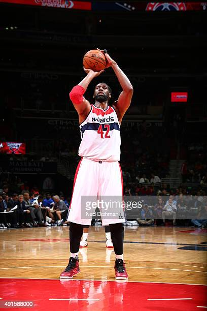 Nene Hilario of the Washington Wizards prepares to shoot a free throw against the Philadelphia 76ers during a preseason game on October 6 2015 at...