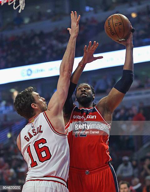 Nene Hilario of the Washington Wizards puts up a shot against Pau Gasol of the Chicago Bulls at the United Center on January 11 2016 in Chicago...