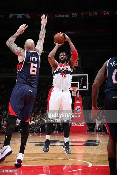 Nene Hilario of the Washington Wizards shoots against Pero Antic of the Atlanta Hawks in Game Four of the Eastern Conference Semifinals during the...