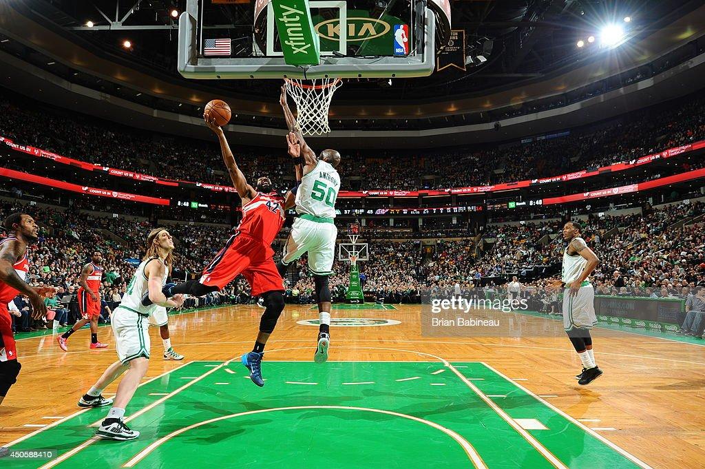Nene Hilario #42 of the Washington Wizards shoots against the Boston Celtics on April 16, 2014 at the TD Garden in Boston, Massachusetts.