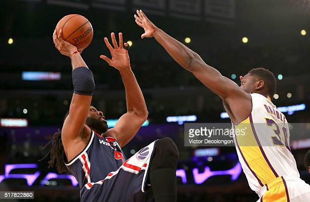 Nene Hilario of the Washington Wizards shoots the running jump shot against Julius Randle of the Los Angeles Lakers during the first half of their...