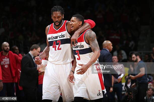 Nene Hilario of the Washington Wizards talks with teammate Bradley Beal in Game Four of the Eastern Conference Semifinals against the Atlanta Hawks...