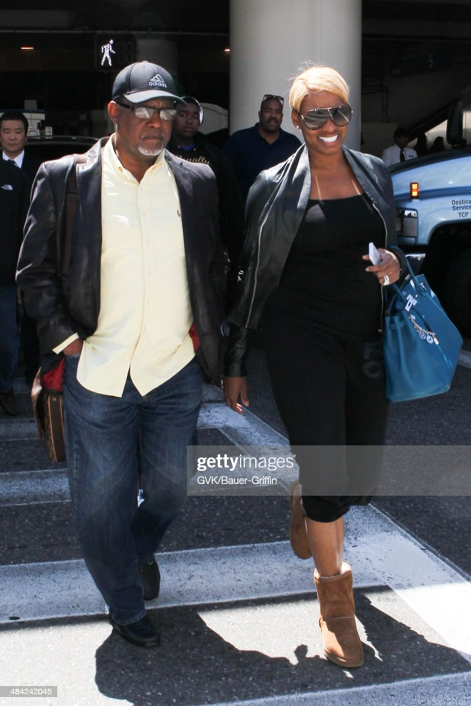 Nene Leakes and <a gi-track='captionPersonalityLinkClicked' href=/galleries/search?phrase=Gregg+Leakes&family=editorial&specificpeople=10059103 ng-click='$event.stopPropagation()'>Gregg Leakes</a> seen at LAX on April 11, 2014 in Los Angeles, California.