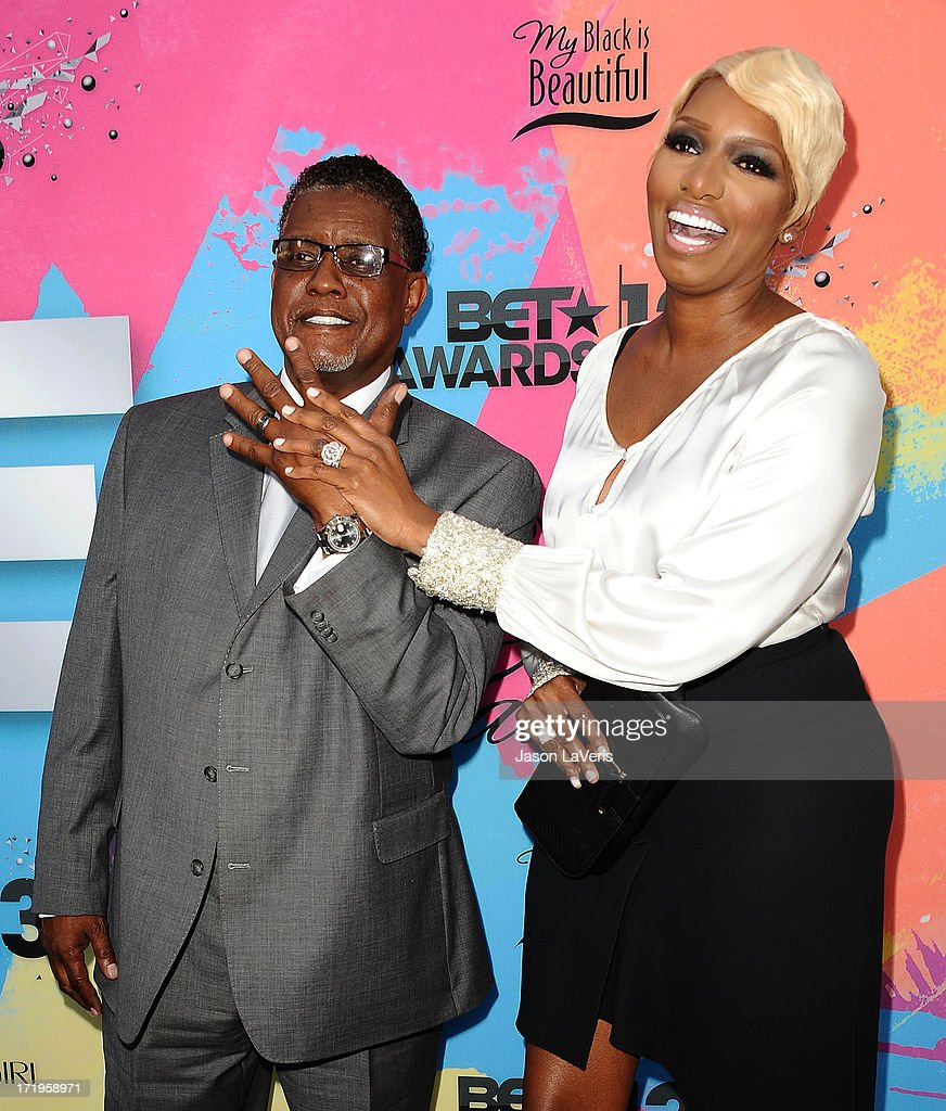 <a gi-track='captionPersonalityLinkClicked' href=/galleries/search?phrase=NeNe+Leakes&family=editorial&specificpeople=5446374 ng-click='$event.stopPropagation()'>NeNe Leakes</a> (R) and husband Gregg Leakes attend Debra L. Lee's 7th annual VIP pre BET dinner event at Milk Studios on June 29, 2013 in Los Angeles, California.