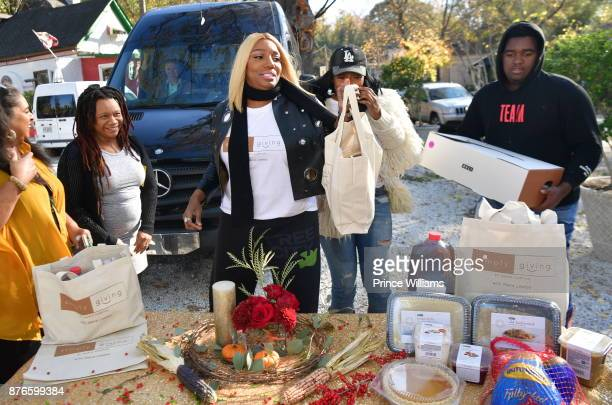 Nene Leakes and Marlo Hampton attend Thanksgiving meal Giveaway with Nene and Marlo at Gio's on November 19 2017 in Atlanta Georgia