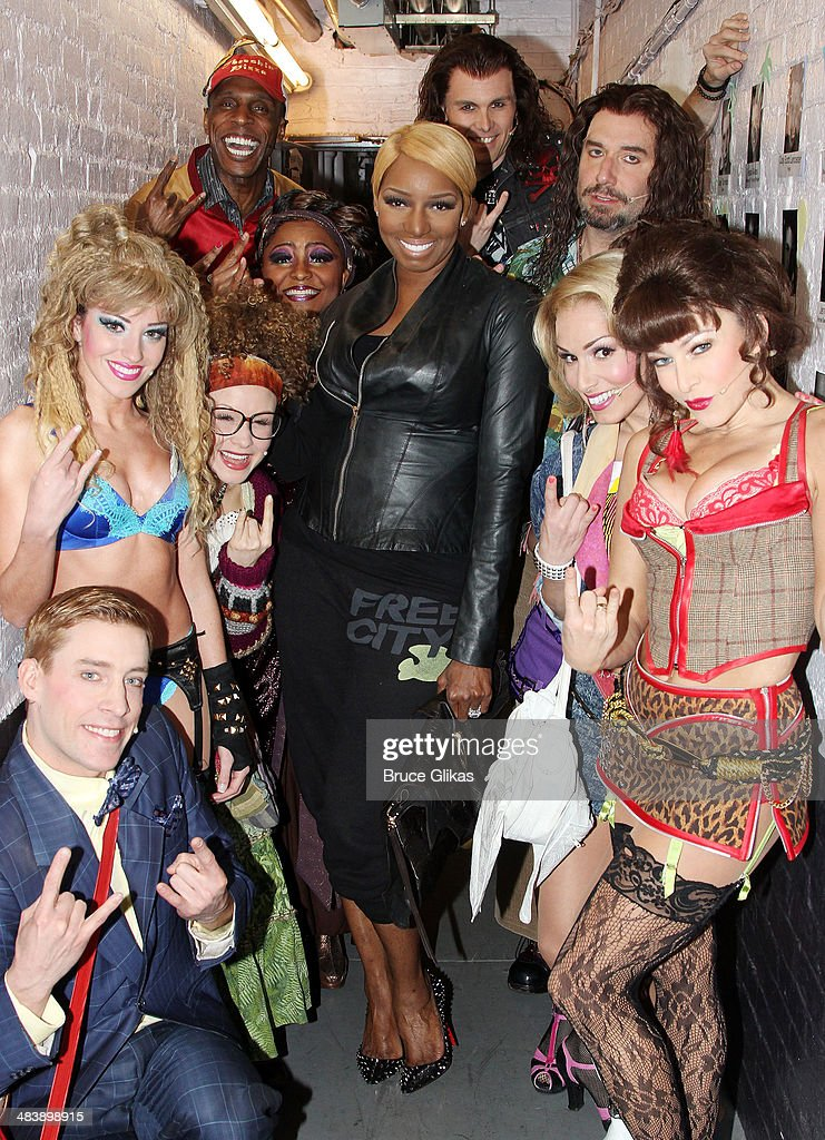 NeNe Leakes poses backstage with the cast of 'Rock Of Ages' on Broadway at The Helen Hayes Theater April 10 2014 in New York City