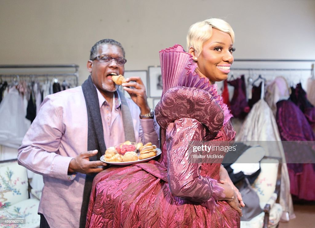 NeNe Leakes with her husband Gregg Leakes filming an episode of 'The Real Housewives of Atlanta' as she meets with designer William Ivey Long for her final 'Cinderella' Costume fitting at Euroco Costumes on November 21, 2014 in New York City.
