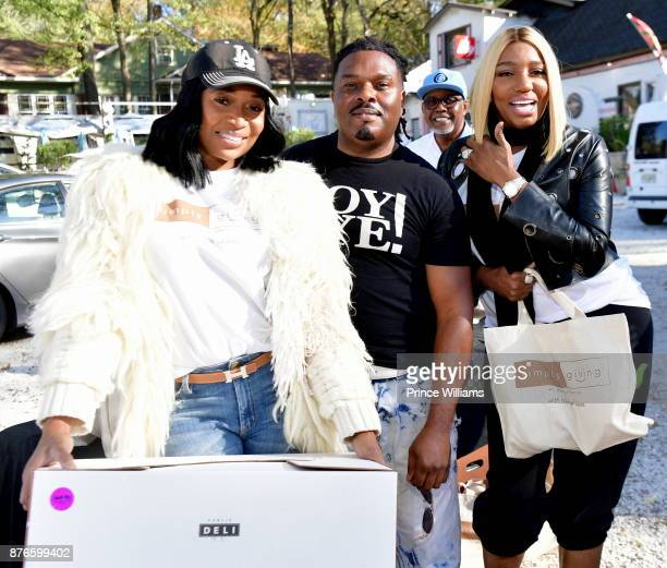 Nene Leaks and Marlo Hampton attend Thanksgiving Meal Giveaway with Nene and Marlo at Gio's on November 19 2017 in Atlanta Georgia