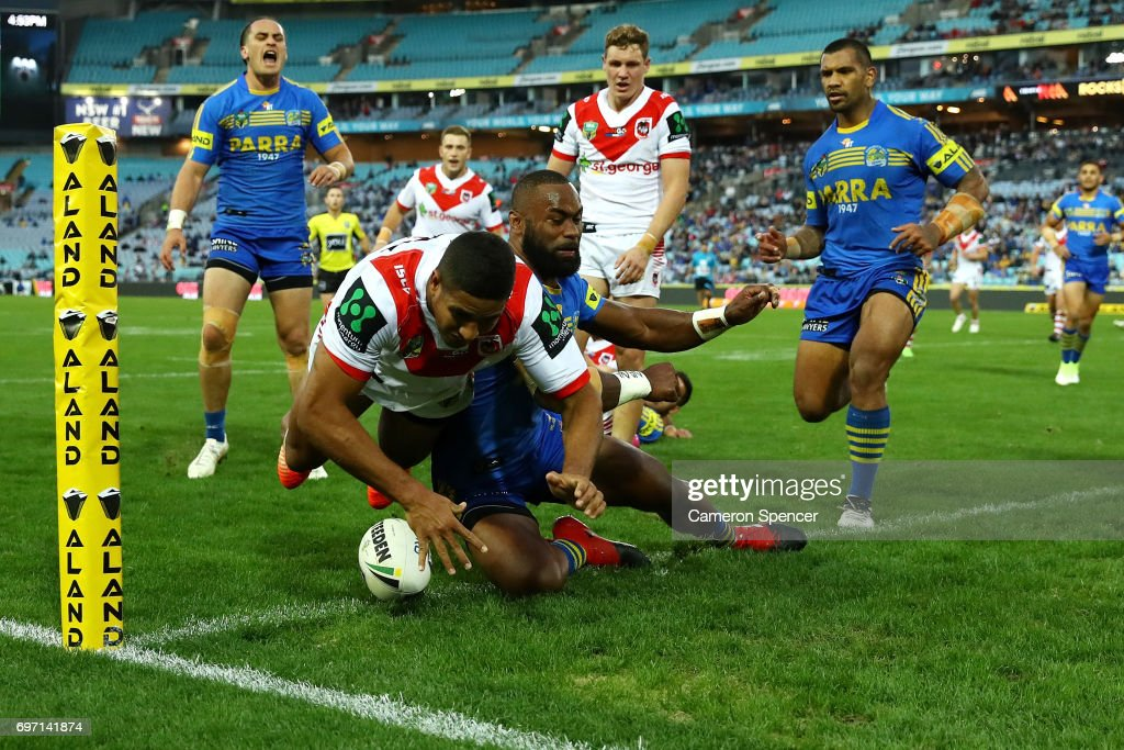 Nene MacDonald of the Dragons scores a try during the round 15 NRL match between the Parramatta Eels and the St George Illawarra Dragons at ANZ Stadium on June 18, 2017 in Sydney, Australia.