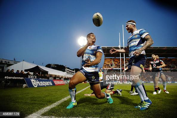 Nene Macdonald of the Titans celebrates after scoring a try during the round 17 NRL match between the New Zealand Warriors and the Gold Coast Titans...