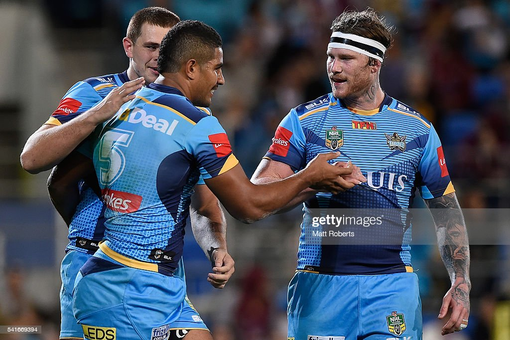 Nene MacDonald of the Titans celebrates scoring a try with team mates during the round 15 NRL match between the Gold Coast Titans and the Manly Sea Eagles at Cbus Super Stadium on June 20, 2016 in Gold Coast, Australia.