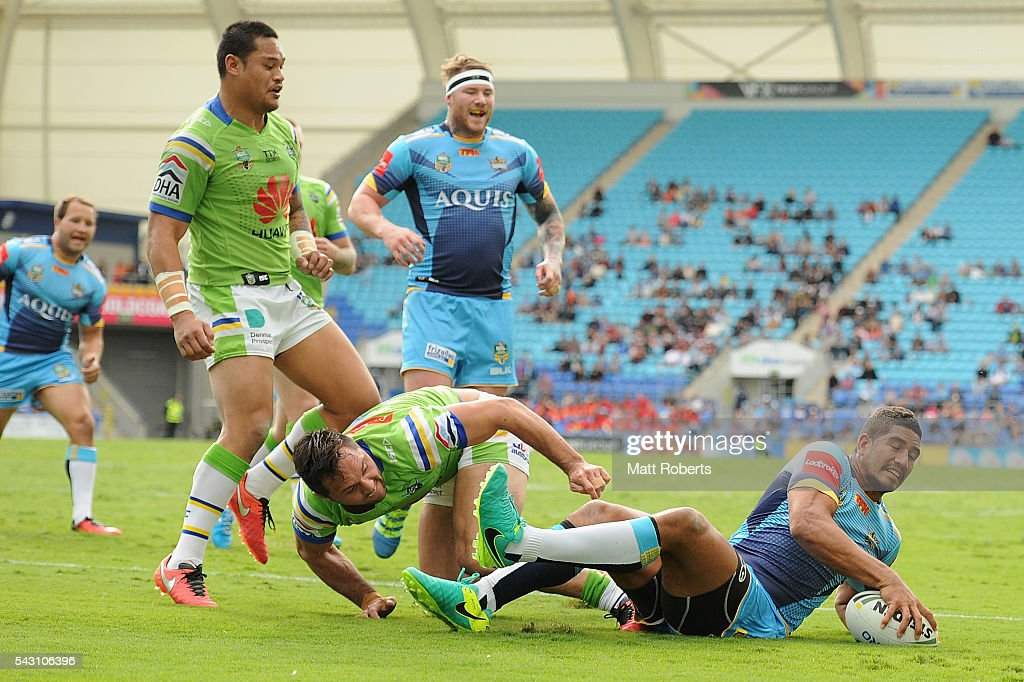 Nene MacDonald of the Titans scores a try during the round 16 NRL match between the Gold Coast Titans and the Canberra Raiders at Cbus Super Stadium on June 26, 2016 in Gold Coast, Australia.