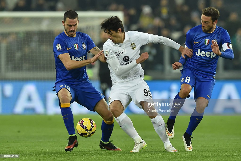 Nene (C) of Hellas Verona FC is challenged by <a gi-track='captionPersonalityLinkClicked' href=/galleries/search?phrase=Claudio+Marchisio&family=editorial&specificpeople=4604252 ng-click='$event.stopPropagation()'>Claudio Marchisio</a> (R) and <a gi-track='captionPersonalityLinkClicked' href=/galleries/search?phrase=Leonardo+Bonucci&family=editorial&specificpeople=6166090 ng-click='$event.stopPropagation()'>Leonardo Bonucci</a> of Juventus FC during the TIM Cup match between Juventus FC and Hellas Verona FC at Juventus Arena on January 15, 2015 in Turin, Italy.