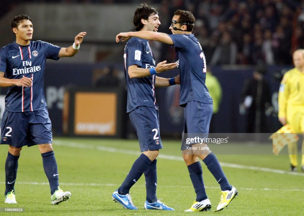 Nene of Paris Saint-Germain FC celebrates his goal with <a gi-track='captionPersonalityLinkClicked' href=/galleries/search?phrase=Javier+Pastore&family=editorial&specificpeople=5857872 ng-click='$event.stopPropagation()'>Javier Pastore</a> (C) and Thiago Silva (L) during the French Ligue 1 match between Paris Saint-Germain FC and Stade Rennais FC, at Parc des Princes on November 17, 2012 in Paris, France.