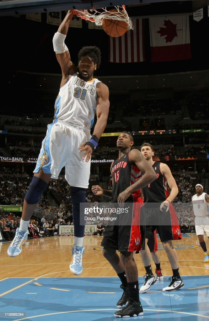 Nene #31 of the Denver Nuggets dunks the ball in front of <a gi-track='captionPersonalityLinkClicked' href=/galleries/search?phrase=Amir+Johnson&family=editorial&specificpeople=556786 ng-click='$event.stopPropagation()'>Amir Johnson</a> #15 of the Toronto Raptors at the Pepsi Center on March 21, 2011 in Denver, Colorado.