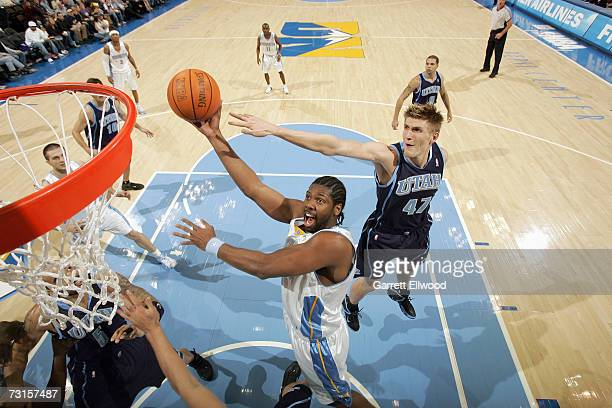 Nene of the Denver Nuggets goes to the basket against Andrei Kirilenko on January 6 2007 at the Pepsi Center in Denver Colorado The Jazz won 9684...