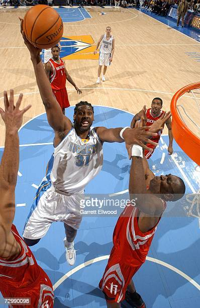 Nene of the Denver Nuggets goes to the basket against the Houston Rockets on January 12 2007 at the Pepsi Center in Denver Colorado NOTE TO USER User...