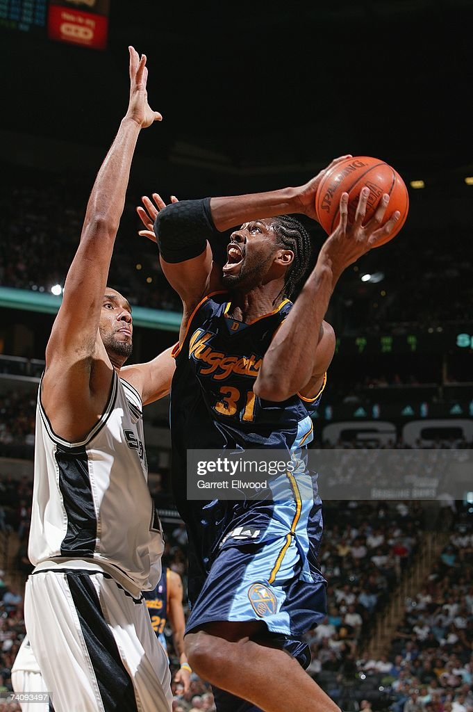 Nene #31 of the Denver Nuggets goes up for a shot over <a gi-track='captionPersonalityLinkClicked' href=/galleries/search?phrase=Tim+Duncan&family=editorial&specificpeople=201467 ng-click='$event.stopPropagation()'>Tim Duncan</a> #21 of the San Antonio Spurs in Game Two of the Western Conference Quarterfinals during the 2007 NBA Playoffs at AT&T Center on April 25, 2007 in San Antonio, Texas. The Spurs won 97-88.