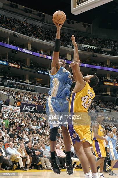 Nene of the Denver Nuggets hooks a shot over Brian Cook of the Los Angeles Lakers at Staples Center on April 3 2007 in Los Angeles California The...