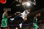 Nene of the Denver Nuggets is called for a technical foul as he dunks against Glen Davis and Kevin Garnett of the Boston Celtics during NBA action at...