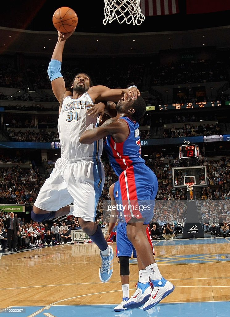 Nene #31 of the Denver Nuggets is fouled by Ben Gordon #7 of the Detroit Pistons as he goes to the basket at the Pepsi Center on March 12, 2011 in Denver, Colorado.