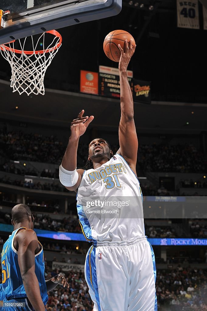 Nene #31 of the Denver Nuggets lays up a shot against the New Orleans Hornets during the game on March 18, 2010 at the Pepsi Center in Denver, Colorado. The Nuggets won 93-80.