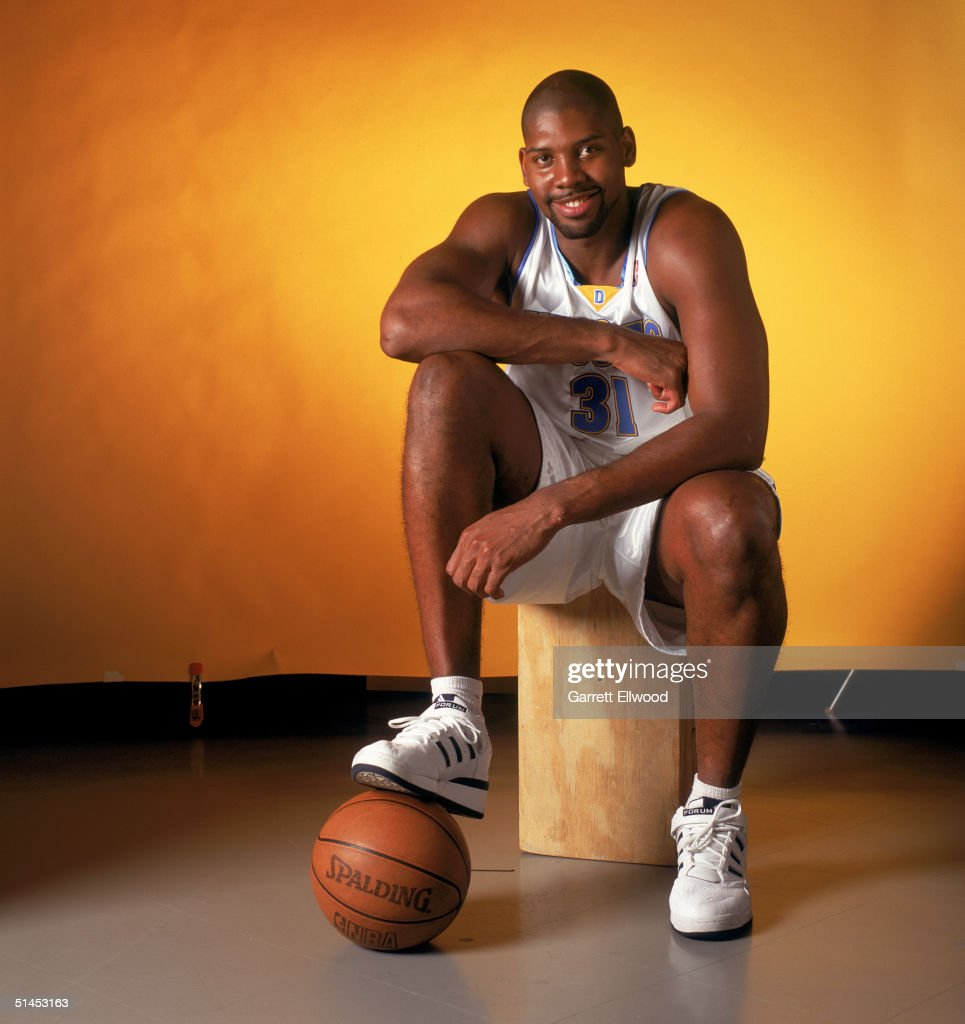 Nene #31 of the Denver Nuggets poses for a portrait during NBA Media Day on October 4, 2004 in Denver, Colorado.