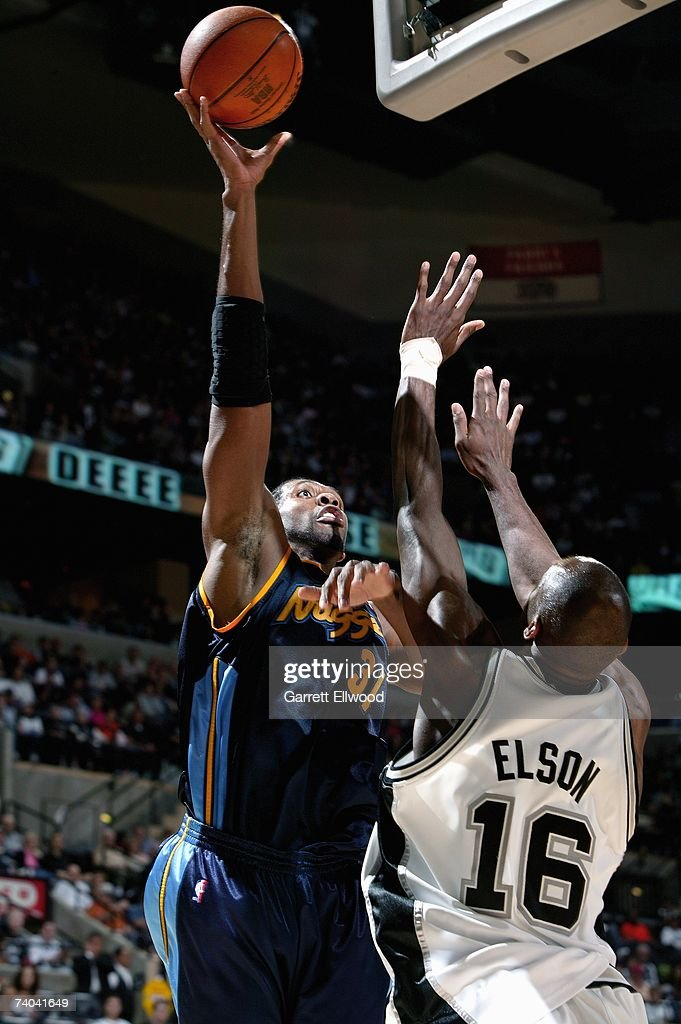 Nene #31 of the Denver Nuggets puts up a shot over Francisco Elson #16 of the San Antonio Spurs in Game One of the Western Conference Quarterfinals during the 2007 NBA Playoffs at AT&T Center on April 22, 2007 in San Antonio, Texas. The Nuggets won 95-89.