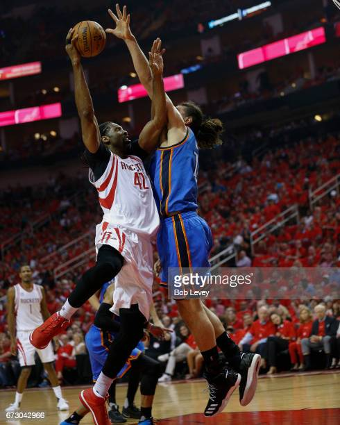 Nene of the Houston Rockets drives on Steven Adams of the Oklahoma City Thunder during Game Five of the Western Conference Quarterfinals game of the...