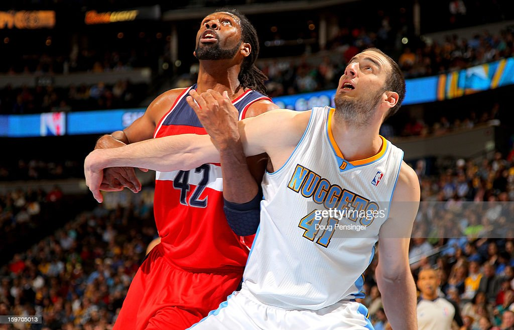 Nene #42 of the Washington Wizards and Kosta Koufos #41 of the Denver Nuggets battle for rebounding position at the Pepsi Center on January 18, 2013 in Denver, Colorado. The Wizards defeated the Nuggets 112-108.