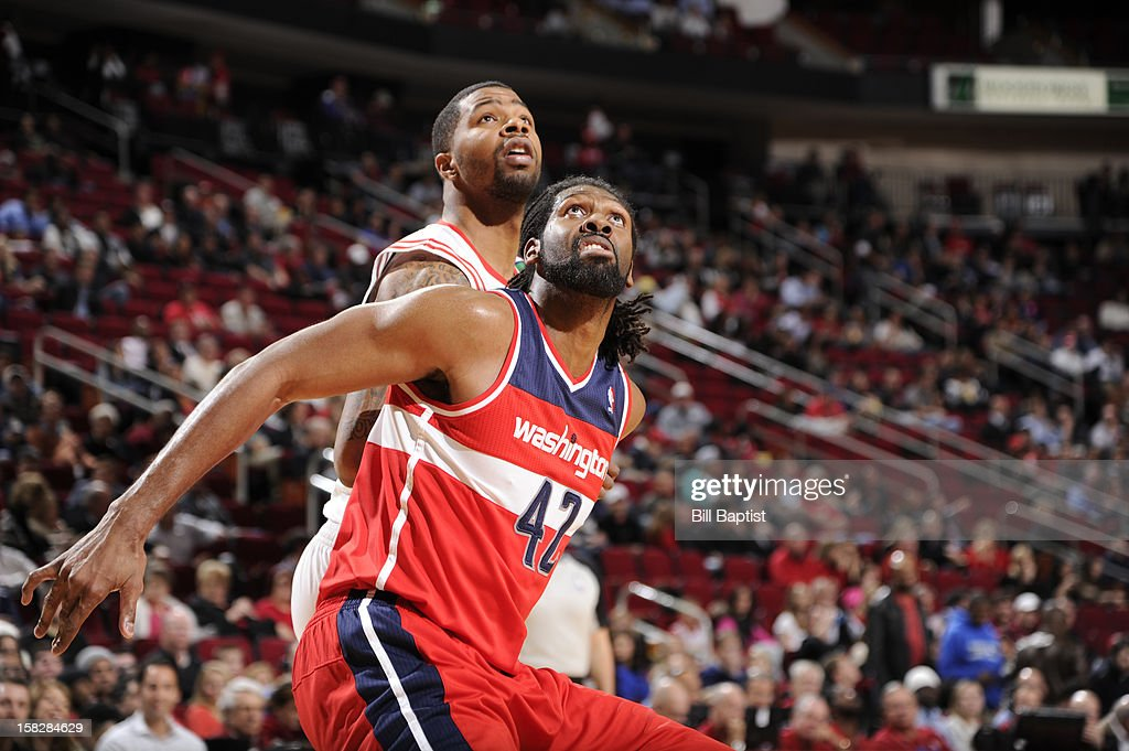 Nene #42 of the Washington Wizards and Marcus Morris #2 of the Houston Rockets battle for a rebound on December 12, 2012 at the Toyota Center in Houston, Texas.