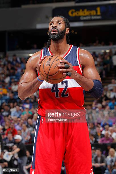 Nene of the Washington Wizards attempts a free throw shot against the Sacramento Kings on March 22 2015 at Sleep Train Arena in Sacramento California...