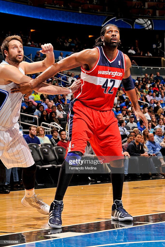 Nene #42 of the Washington Wizards battles for rebound position against former Orlando Magic player <a gi-track='captionPersonalityLinkClicked' href=/galleries/search?phrase=Josh+McRoberts+-+Basketball+Player&family=editorial&specificpeople=732530 ng-click='$event.stopPropagation()'>Josh McRoberts</a> on December 19, 2012 at Amway Center in Orlando, Florida.