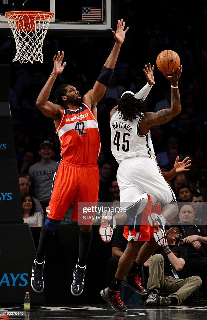 Nene (L) of the Washington Wizards blocks Gerald Wallace (R) of the Brooklyn Nets at the Barclay Center March 8, 2013 in the Brooklyn borough of New York. AFP PHOTO/Stan HONDA