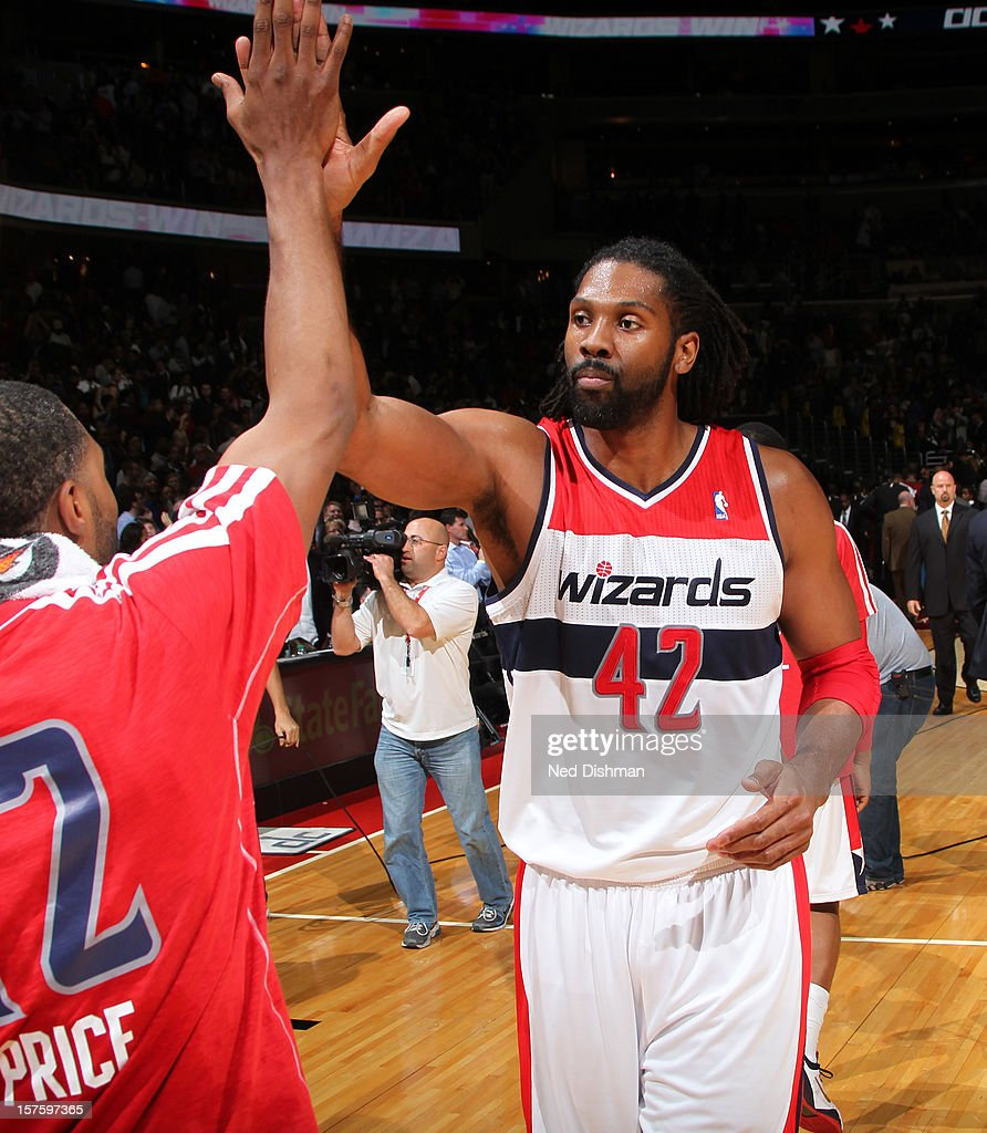Nene #42 of the Washington Wizards celebrates a win against the Miami Heat during the game at the Verizon Center on December 4, 2012 in Washington, DC.