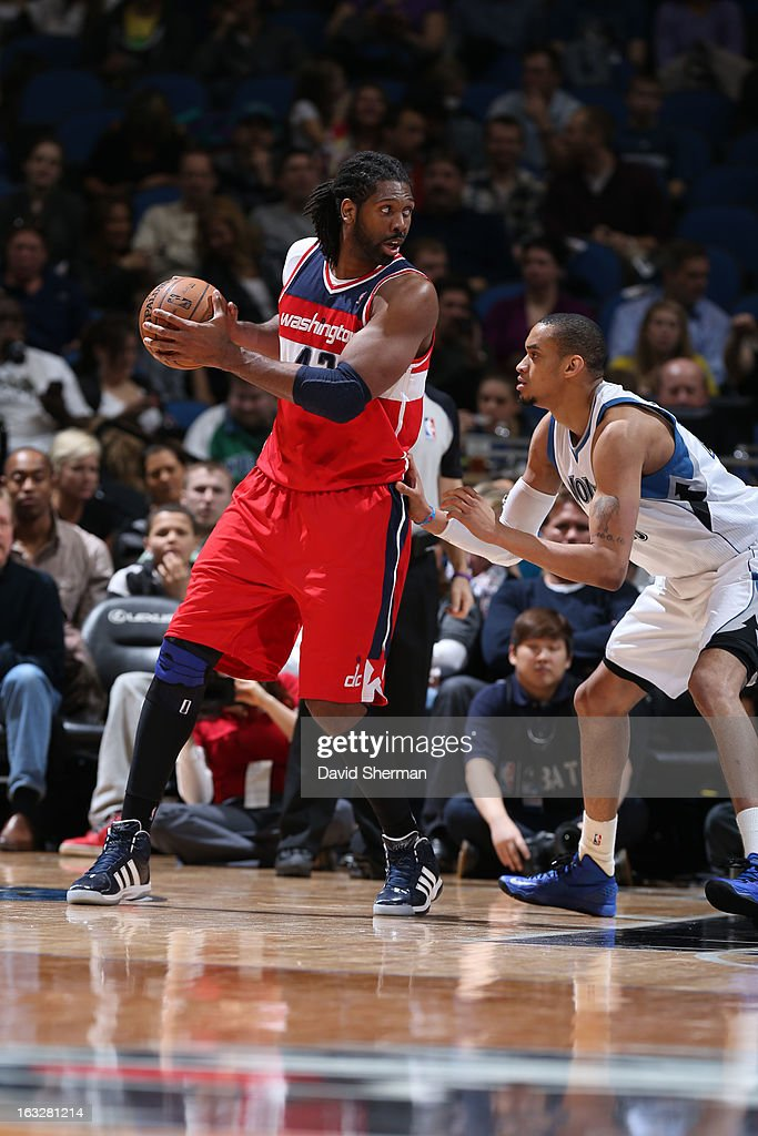 Nene #42 of the Washington Wizards controls the ball against Chris Johnson #20 of the Minnesota Timberwolves on March 6, 2013 at Target Center in Minneapolis, Minnesota.
