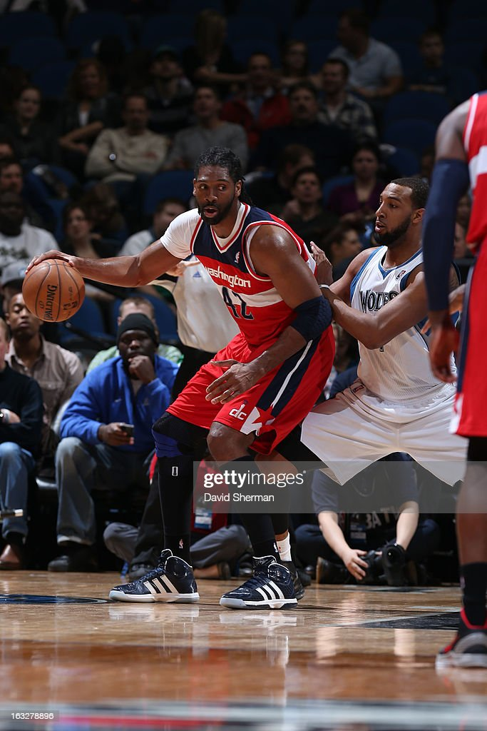 Nene #42 of the Washington Wizards controls the ball against Derrick Williams #7 of the Minnesota Timberwolves on March 6, 2013 at Target Center in Minneapolis, Minnesota.
