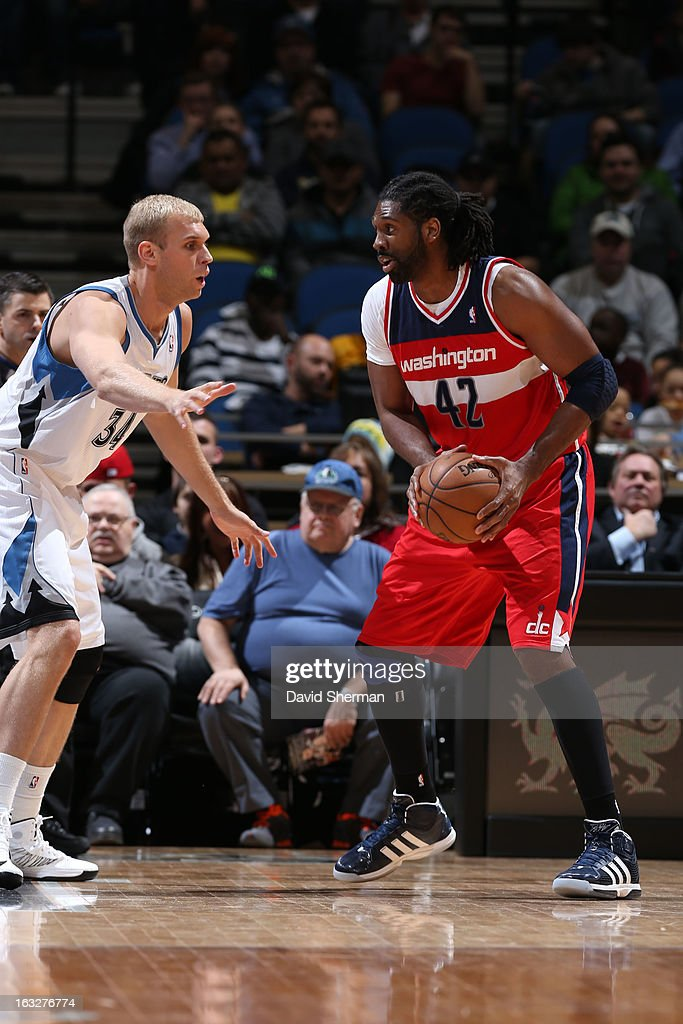 Nene #42 of the Washington Wizards controls the ball against Greg Stiemsma #34 of the Minnesota Timberwolves on March 6, 2013 at Target Center in Minneapolis, Minnesota.