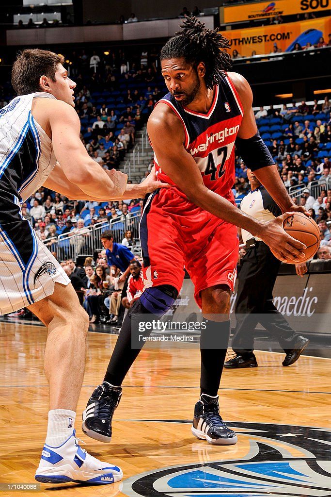 Nene #42 of the Washington Wizards controls the ball against Nikola Vucevic #9 of the Orlando Magic on December 19, 2012 at Amway Center in Orlando, Florida.