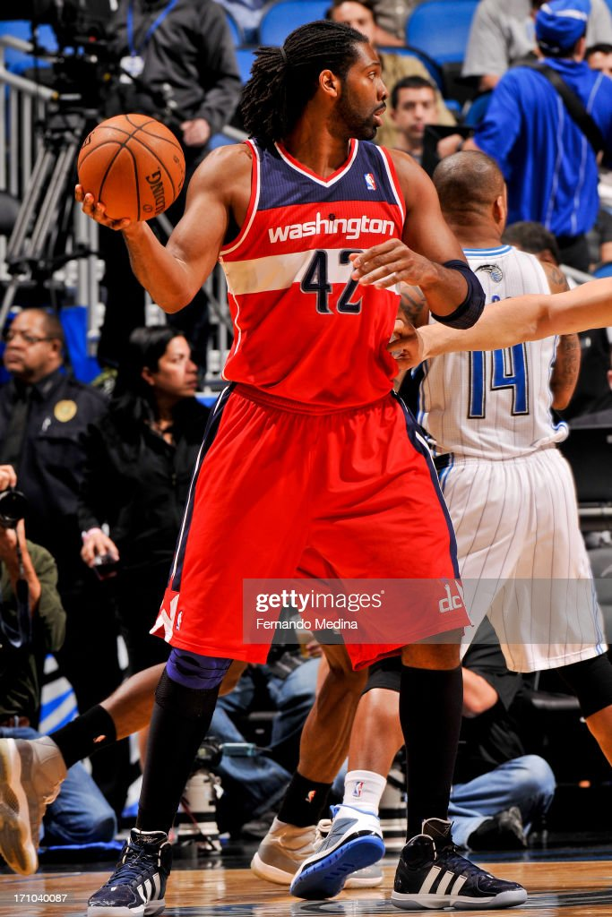 Nene #42 of the Washington Wizards controls the ball against the Orlando Magic on December 19, 2012 at Amway Center in Orlando, Florida.