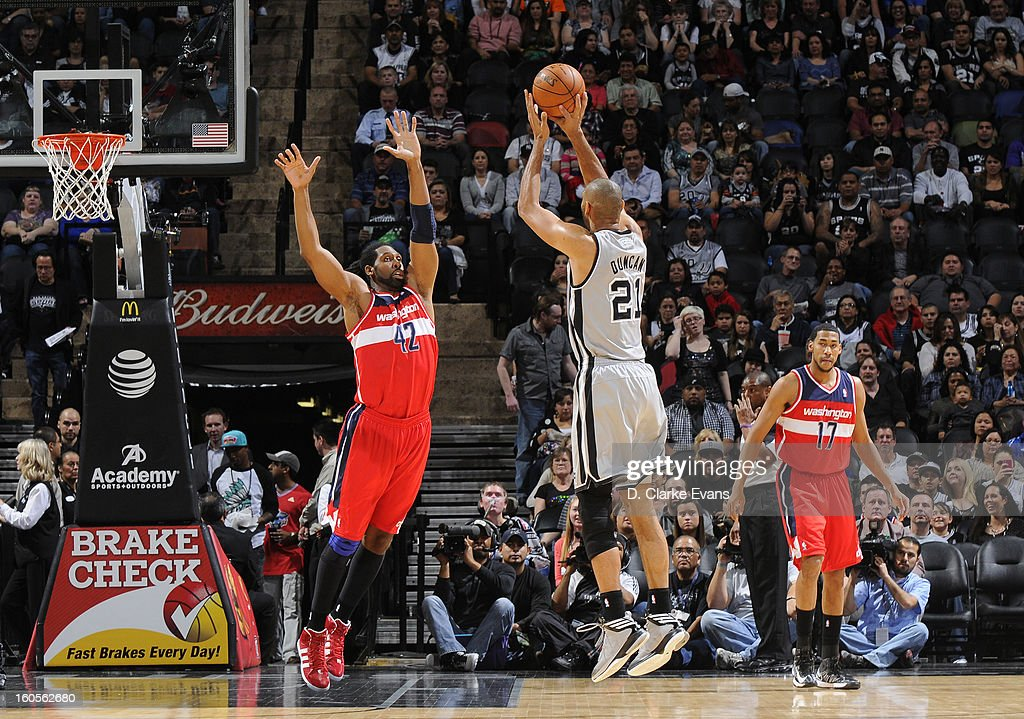 Nene #42 of the Washington Wizards defends against Tim Duncan #21 of the San Antonio Spurs during the game between the Washington Wizards and the San Antonio Spurs on February 2, 2013 at the AT&T Center in San Antonio, Texas.