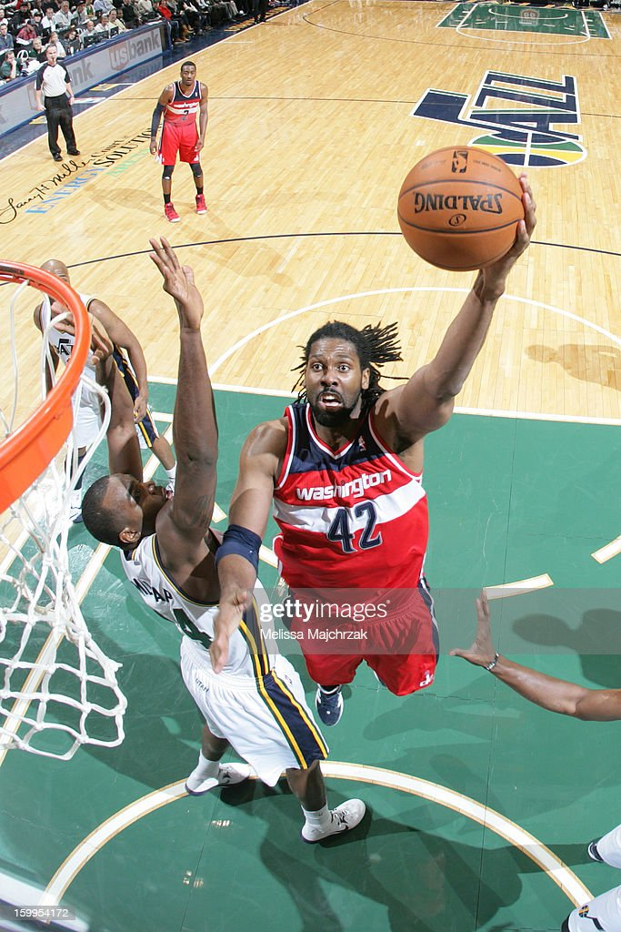 Nene #42 of the Washington Wizards drives to the basket against <a gi-track='captionPersonalityLinkClicked' href=/galleries/search?phrase=Paul+Millsap&family=editorial&specificpeople=880017 ng-click='$event.stopPropagation()'>Paul Millsap</a> #24 of the Utah Jazz at Energy Solutions Arena on January 23, 2013 in Salt Lake City, Utah.