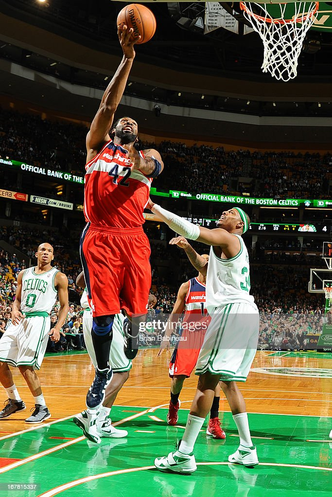 BOSTON, MA - APRIL 7 Nene #42 of the Washington Wizards drives to the basket against <a gi-track='captionPersonalityLinkClicked' href=/galleries/search?phrase=Paul+Pierce&family=editorial&specificpeople=201562 ng-click='$event.stopPropagation()'>Paul Pierce</a> #34 of the Boston Celtics on April 7, 2013 at the TD Garden in Boston, Massachusetts.
