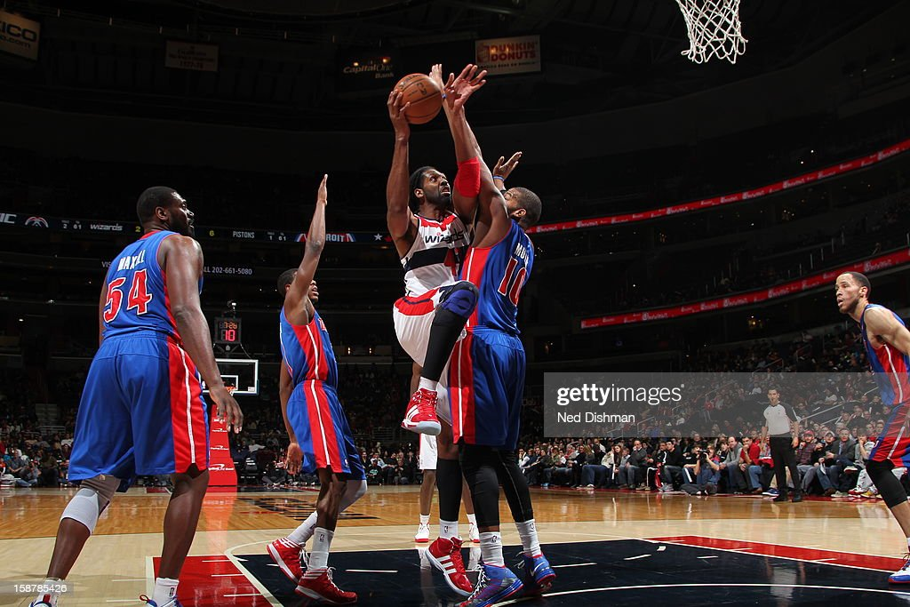 Nene #42 of the Washington Wizards drives to the basket against the Detroit Pistons at the Verizon Center on December 22, 2012 in Washington, DC.