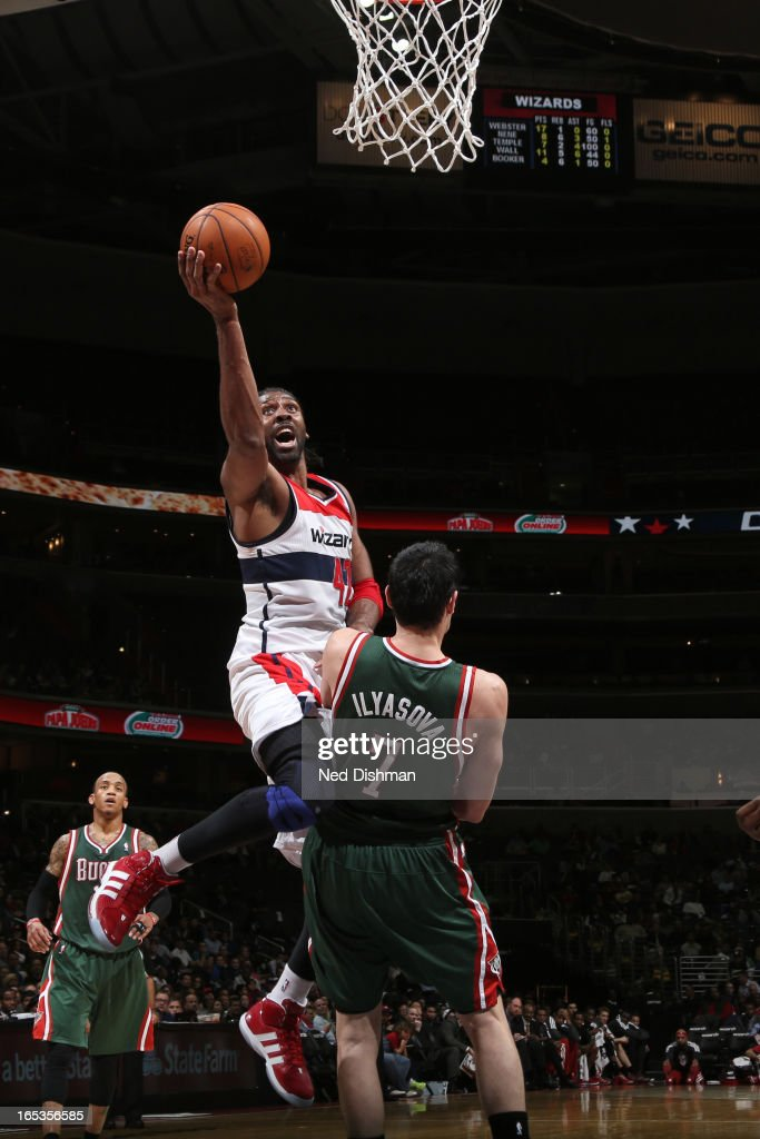 Nene #42 of the Washington Wizards drives to the basket against the Milwaukee Bucks at the Verizon Center on March 13, 2013 in Washington, DC.