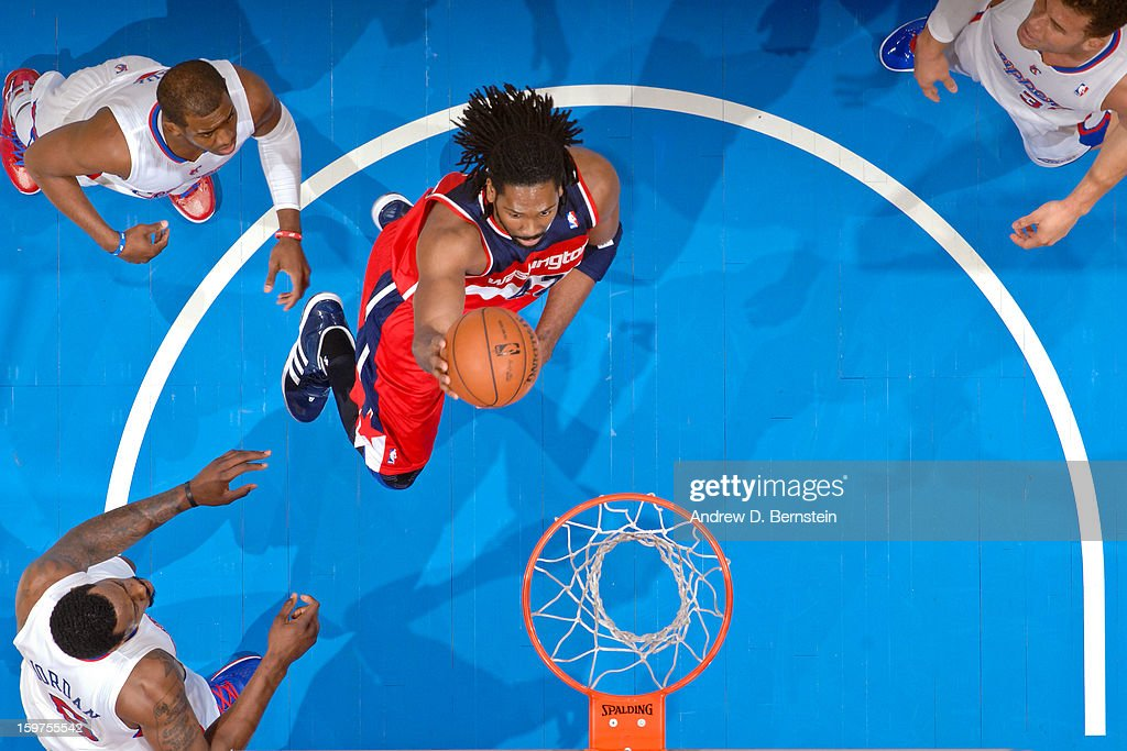 Nene #42 of the Washington Wizards drives to the basket against the Los Angeles Clippers at Staples Center on January 19, 2013 in Los Angeles, California.